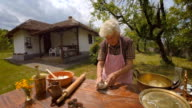 Cooking With Grandma-Old Farmer Lady Making a Loaf of Bread video
