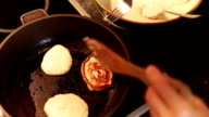 Cooking-manual footage: fritters being fried in the pan video