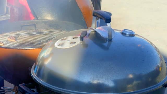 Cooks grilled hamburger patties video