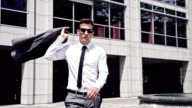 SLO MO Cool businessman throwing a jacket over his shoulder video
