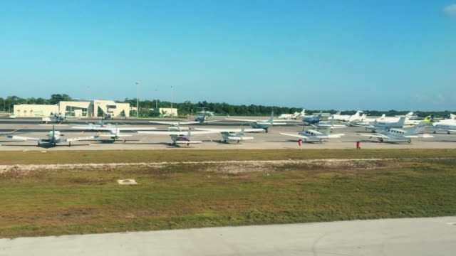 Cool daytime shot of Airplanes parked on a runway video