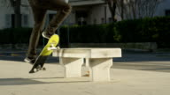 SLOW MOTION: Cool skateboarder doing tricks jumping and sliding on the bench video