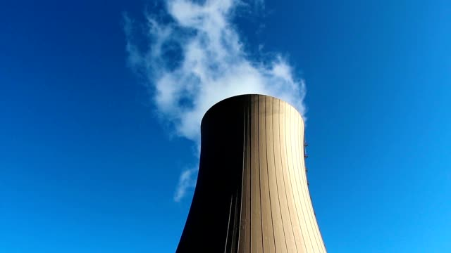 Cooling tower of nuclear power plant against blue sky video
