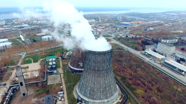 Cooling towers of a power plant fuming, steaming video