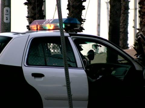 Cop in Police Car at Crime Scene video