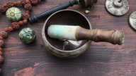 Copper Singing Bowl with Asian religious objects video