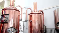 Copper tuns for brewing at a brewery video