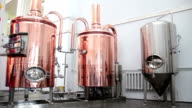 Copper tuns for brewing at brewery video