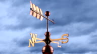 Copper Weather vane against a stormy sky video