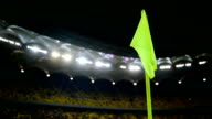 Corner flag post on soccer stadium at night video