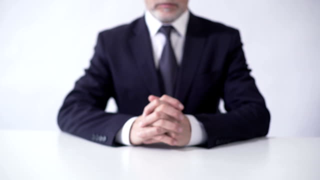 Corporation board chairman sitting at office desk, successful business career video