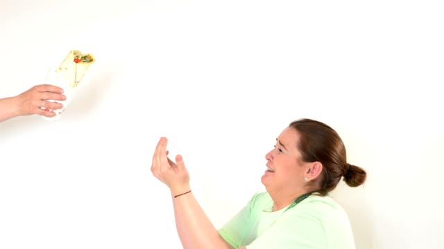 Corpulent woman having addiction to unhealthy food video