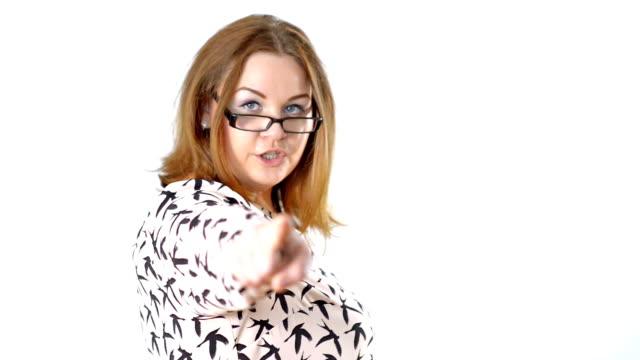 Corpulent woman pointing toward camera video