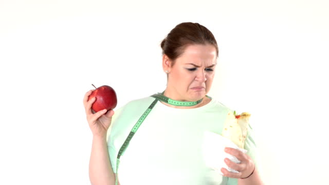 Corpulent woman struggle to eat healthy video