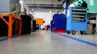 Corridor in factory with industrial equipment - low angle view video