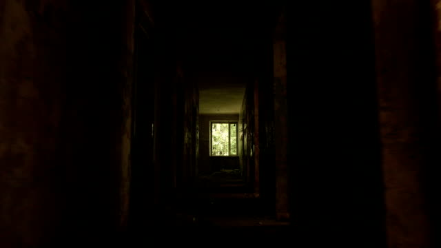 Corridor in the abandoned house. Smooth and slow steady cam shot. video