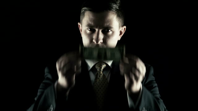 Corruption, The person in a suit closed a eyes a one-dollar banknote video