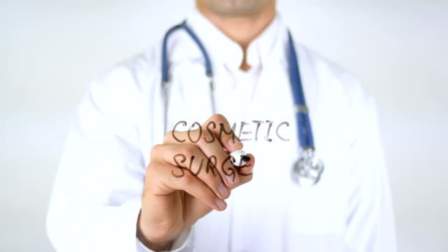 Cosmetic Surgery , Doctor Writing on Glass video