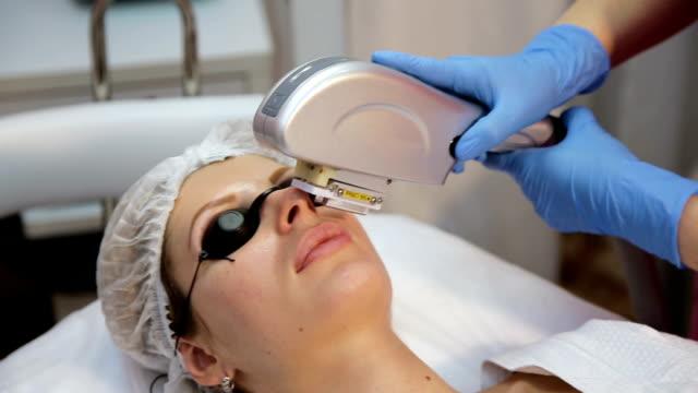 Cosmetician perfiming photo rejuvenation video