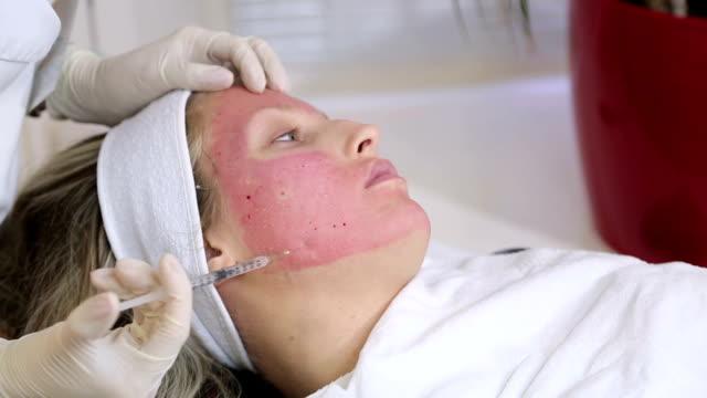 Cosmetologist making botox injection video