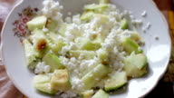 Cottage cheese and green apples on the plate,Healthy food.time-lapse video