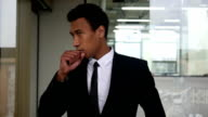 Coughing Young Black Businessman in Office video