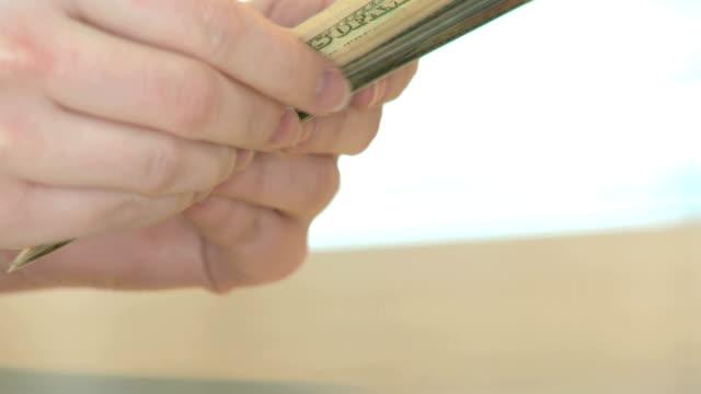 Counting dollar banknotes close up video