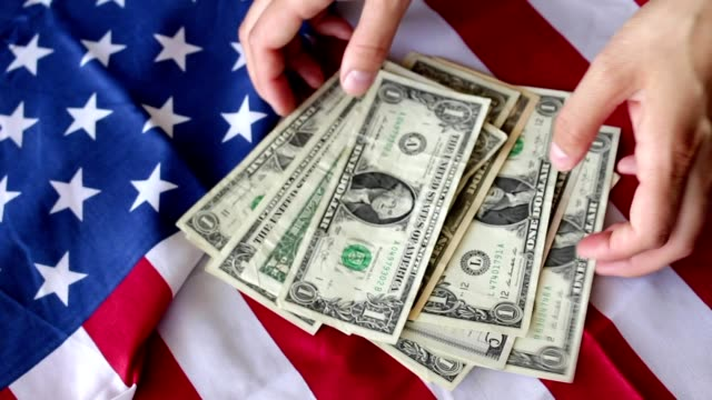 counting dollars with flag video