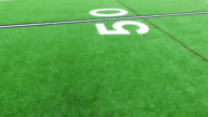 Counting Down Yard Lines close to Green Astro Turf Football Field perfect close angle video