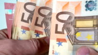 Counting Euro banknotes, slow motion video