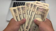Counting Japanese Yen with laptop video