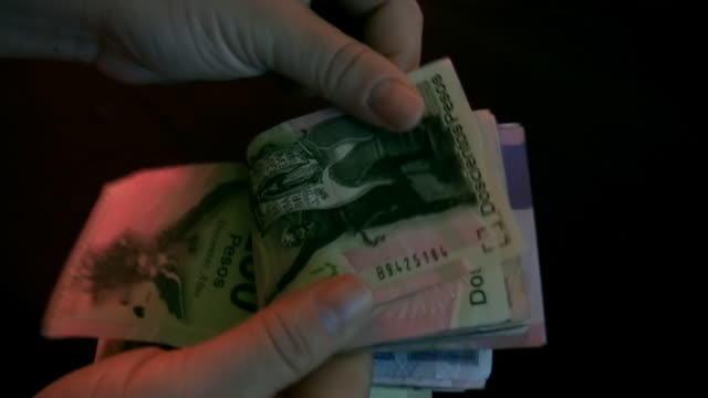 Counting Mexican Bills (HD) video