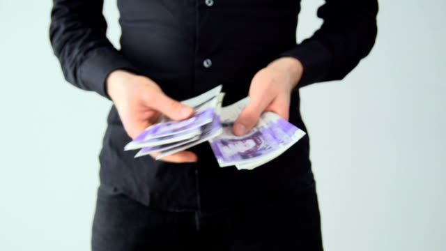 Counting money - British Pounds video