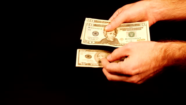 Counting money cash dollars bills in hands. video