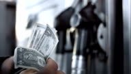 HD: Counting Money For Gas Tank video