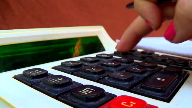Counting Money On a Old Calculator video