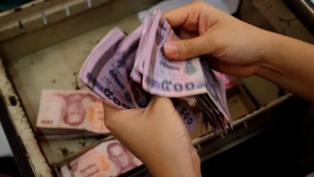Counting money, Thailand. video