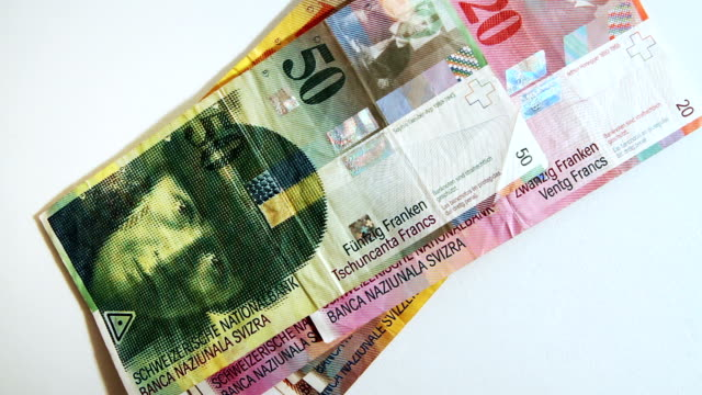 Counting Swiss Francs Currency Notes By Hand video