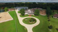 Country horse ranch, mansion with barns,pens,pool, aerial flyby video