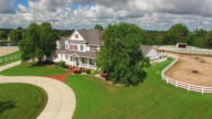 Country ranch, mansion with horse barns,pens,pool, aerial flyby video