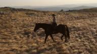 HD: Country Woman Riding Through The Prairie video