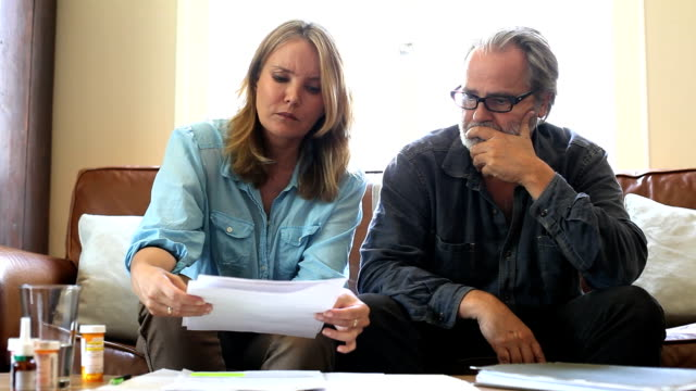 Couple add up medical bills warily video