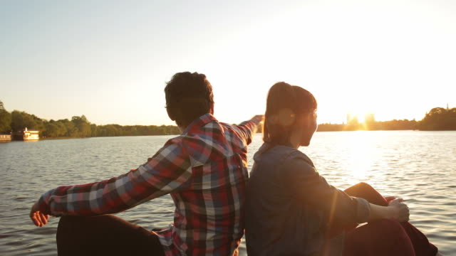 Couple admiring the view at sunset. video