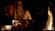Couple and campfire. Split screen. video