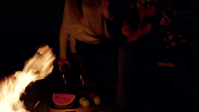 Couple and campfire video