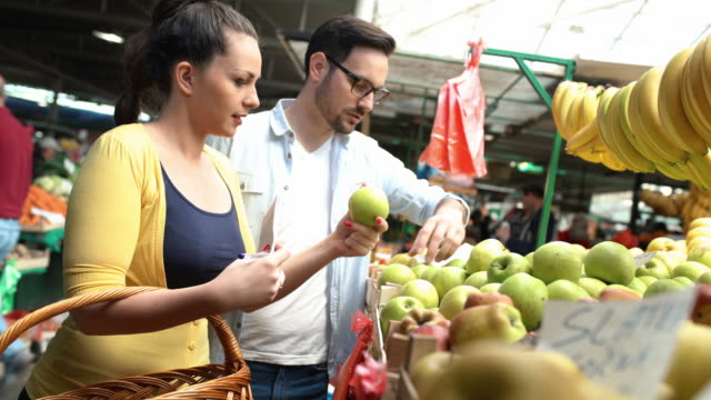 Couple at food market. video