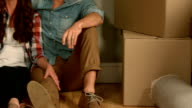 Couple at home sitting on floor video