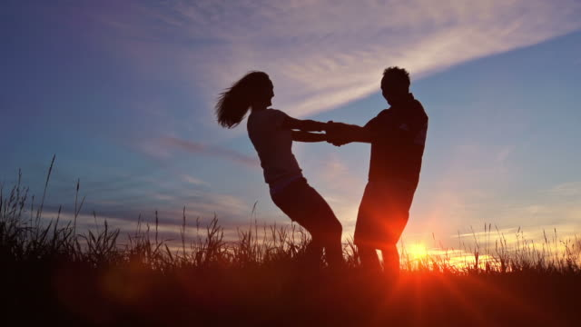 Couple at sunset show their love for each other video