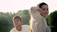 Couple awakening on lake video