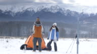 4K Couple backpackers camping in snow mountain video